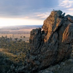 Rockclimbers on top of the Pharos at Mt Arapiles, Victoria, Australia.