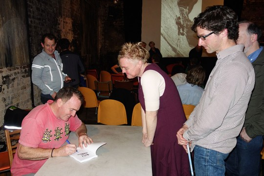 Michael signing books. Gitti Bulloch waiting expectantly with Steve Pollard behind.